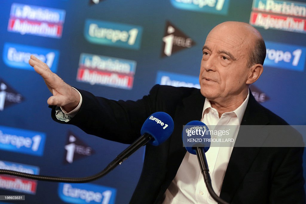 Bordeaux mayor and founder of the French opposition right-wing UMP party, Alain Juppe answers journalists' questions as he participates in the 'Le Grand Rendez-Vous' program at the headquarters of French radio station Europe 1 in Paris, on November 25, 2012. Party heavyweight Juppe, a former premier and foreign minister, will hold a mediation meeting later in the day with the right-winger, who was declared the winner of November 22 knife-edge vote to pick a party leader, Jean-Francois Cope, and his centrist rival Francois Fillon. The talks are to establish who actually won the leadership and whether mutual allegations of ballot rigging have any foundation.