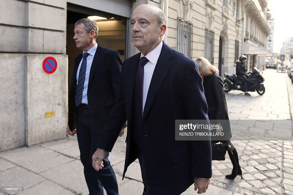 Bordeaux mayor and founder of the French opposition right-wing UMP party, Alain Juppe (R) arrives to participate in the 'Le Grand Rendez-Vous' program at the headquarters of French radio station Europe 1 in Paris, on November 25, 2012. Party heavyweight Juppe, a former premier and foreign minister, will hold a mediation meeting later in the day with the right-winger, who was declared the winner of November 22 knife-edge vote to pick a party leader, Jean-Francois Cope, and his centrist rival Francois Fillon. The talks are to establish who actually won the leadership and whether mutual allegations of ballot rigging have any foundation.