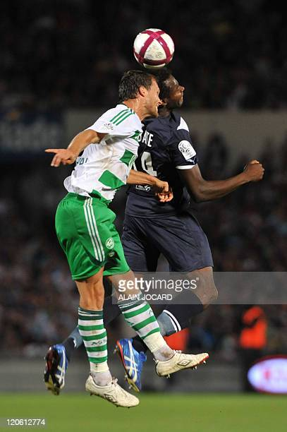 Bordeaux' midfielder Abdou Traore fights for the ball with SaintEtienne's defender Sylvain Marchal during the French L1 football match Bordeaux vs...