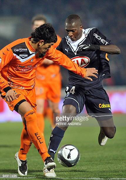 Bordeaux' midfielder Abdou Traore vies with Lorient's defender Franco Sosa during their French L1 football match Bordeaux vs Lorient on December 19...