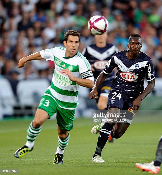 Bordeaux' midfielder Abdou Traore vies with SaintEtienne' US defender Carlos Bocanegra during their French L1 football match Bordeaux vs SaintEtienne...