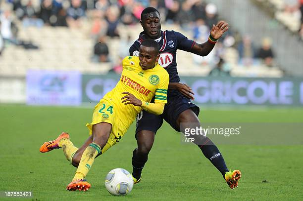 Bordeaux' midfielder Henri Saivet vies with Nantes' defender Issa Cissokho during the French L1 football match Bordeaux vs Nantes on November 10 2013...