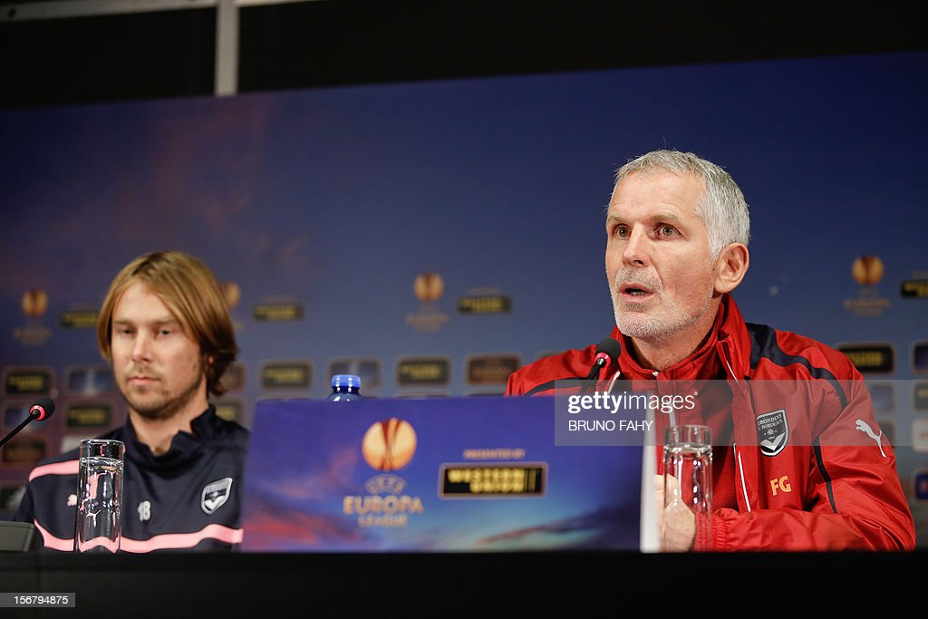 Bordeaux midfielder Jaroslav Plasil (L) and head coach Francis Gillot attend a press conference on November 21,2012 in Bruges on the eve of their UEFA Europa League Group D football match against Club Brugge. AFP PHOTO / BELGA PHOTO BRUNO FAHY