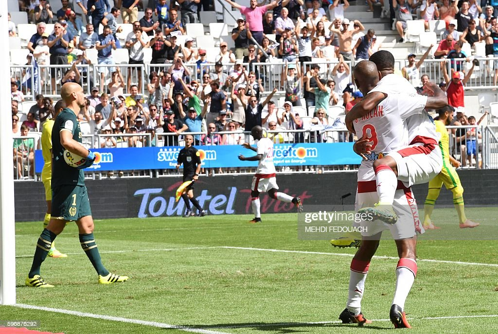 Bordeaux' players celebrate after a goal scored by their teammate Uruguay forward Diego Rolan during the French L1 football match Bordeaux vs Nantes...
