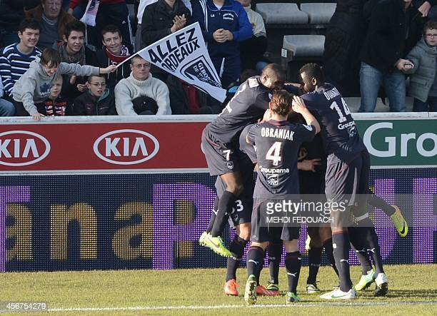 Bordeaux' players celebrate after scoring during the French L1 football match Bordeaux vs Valenciennes on December 15 2013 at ChabanDelmas stadium in...