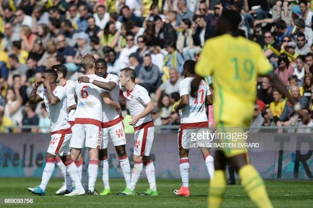Bordeaux 's French midfielder Younousse Sankhare celebrates with teammates after scoring a goal during the French L1 football match Nantes vs...