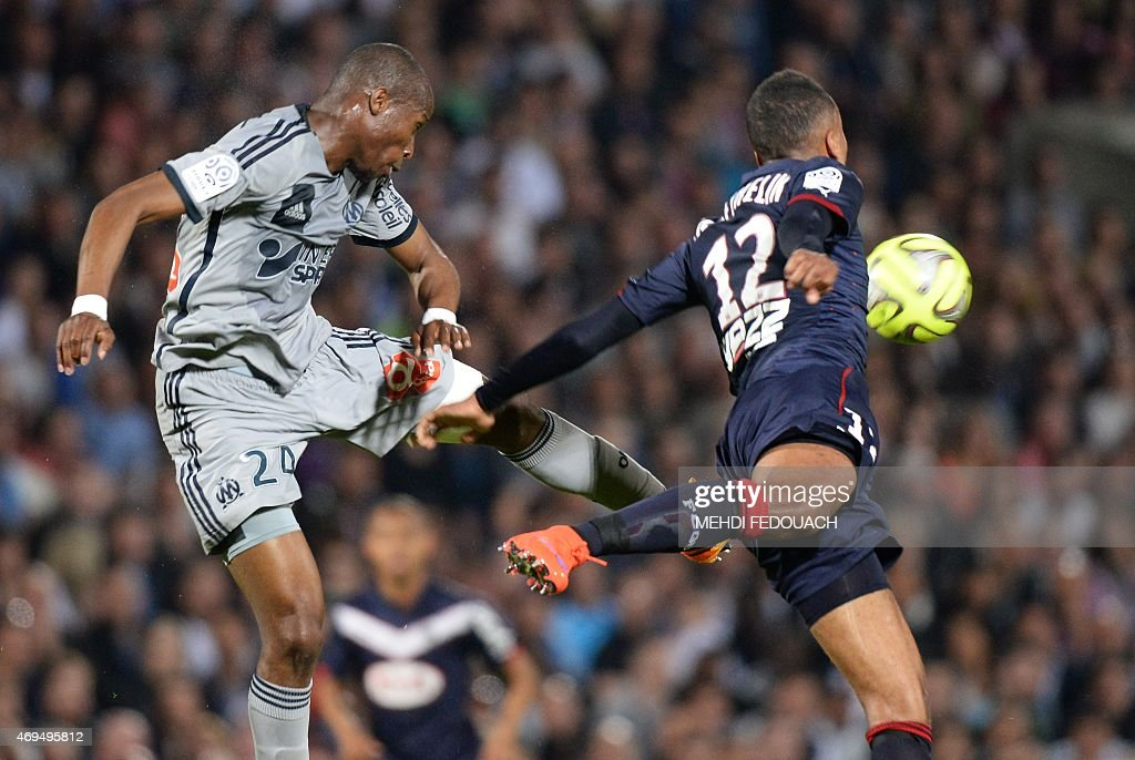 Bordeaux' s Isaac Thelin vies with Marseille' s Rod Fanni during the French L1 football match between Girondins de Bordeaux and Marseille on April 12...