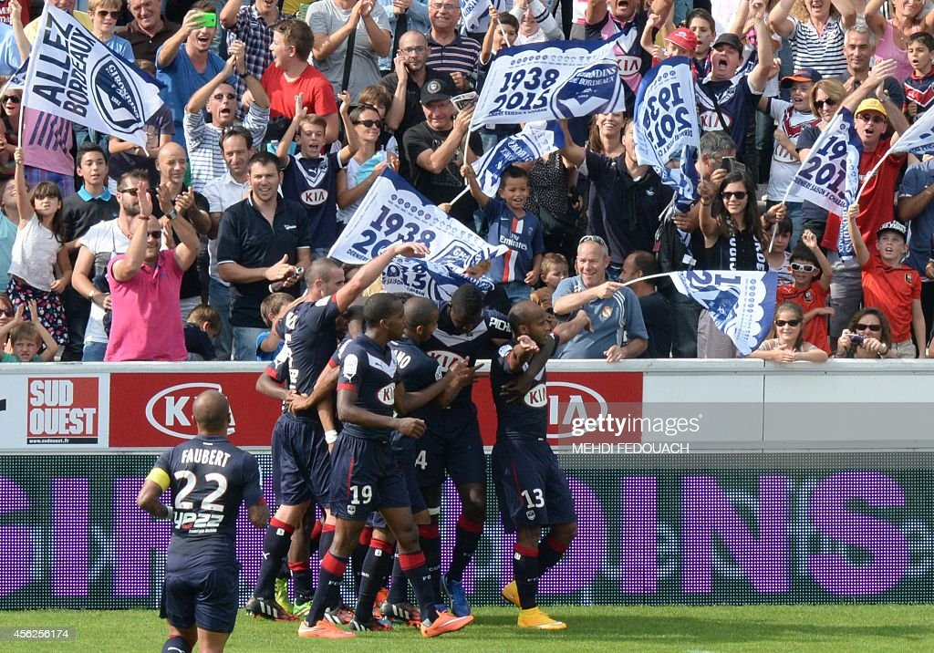 Bordeaux' s Thomas Toure is congratulated by teammates after scoring the second goal during the French L1 footbal match Bordeaux vs Rennes on...