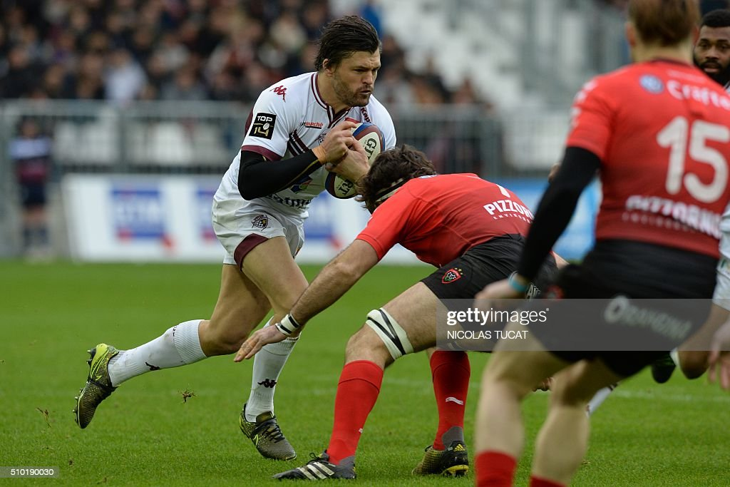 Bordeaux-Begles' Australian wing Adam Ashley-Cooper runs with the ball during the French Top 14 rugby union match between Bordeaux-Begles (UBB) and Toulon on February 14, 2016 at the Matmut Atlantique stadium in Bordeaux, southwestern France. AFP PHOTO / NICOLAS TUCAT / AFP / NICOLAS TUCAT