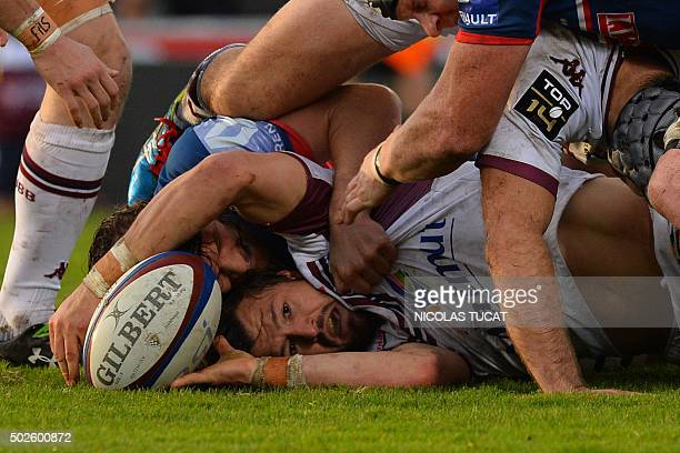 BordeauxBegles' Australian winger Adam AshleyCooper vies with Grenoble's players during the French Top 14 rugby union match between BordeauxBegles...