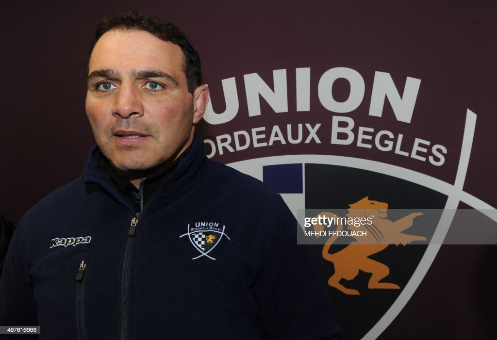 Bordeaux-Begles (UBB) club's French coach Raphael Ibanez speaks to journalists during a press conference on March 26, 2015 in Begles, southwestern France. Bordeaux's club president Laurent Marti commented that rumors about the replacement of France's team head coach Philippe Saint-Andre by Raphael Ibanez were 'very painful'. AFP PHOTO/MEHDI FEDOUACH
