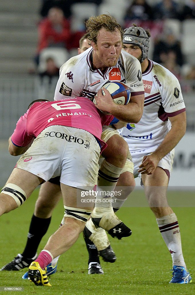 Bordeaux-Begles' flanker Luke Braid of New Zealand runs with the ball during the French Top 14 rugby union match between Bordeaux-Begles and Stade Fran��ais on April 30, 2016 at the Matmut Atlantique Stadium in Bordeaux, western France.