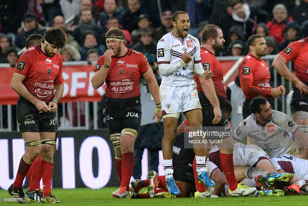 Bordeaux-Begles' French fullback Darly Domvo (C) reacts after winning the French Top 14 rugby union match between Bordeaux-Begles and Toulon on February 14, 2016 at the Matmut Atlantique stadium in Bordeaux, southwestern France. AFP PHOTO / NICOLAS TUCAT / AFP / NICOLAS TUCAT