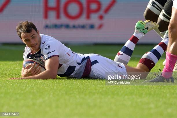 BordeauxBegles' French fullback Nans Ducuing scores a try during the French Top 14 rugby union match between BordeauxBegles and Stade Francais on...