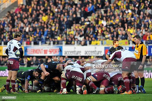 BordeauxBegles' French scrumhalf Baptiste Serin holds the ball as Clermont's and Bordeaux's players prepare for a scrum during the European Rugby...