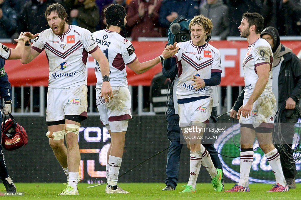 Bordeaux-Begles' players celebrate after winning the French Top 14 rugby union match between Bordeaux-Begles and Toulon on February 14, 2016 at the Matmut Atlantique stadium in Bordeaux, southwestern France. AFP PHOTO / NICOLAS TUCAT / AFP / NICOLAS TUCAT