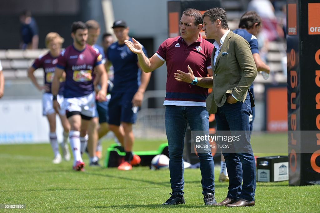 Bordeaux-Begles' rugby union club French president Laurent Marti (R) talks to manager Raphael Ibanez (L) prior to the start of the French Top 14 rugby union match between Bordeaux-Begles and Brive on May 28, 2016 at the Chaban-Delmas stadium in Bordeaux, southwestern France.