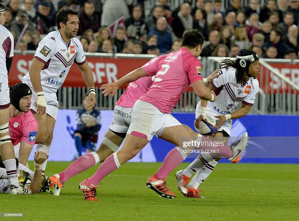 Bordeaux-Begles' South African scrumhalf Heini Adams (R) plays the ball during the French Top 14 rugby union match Bordeaux-Begles vs Stade Fran��ais on April 30, 2016 at the Matmut Atlantique Stadium in Bordeaux.
