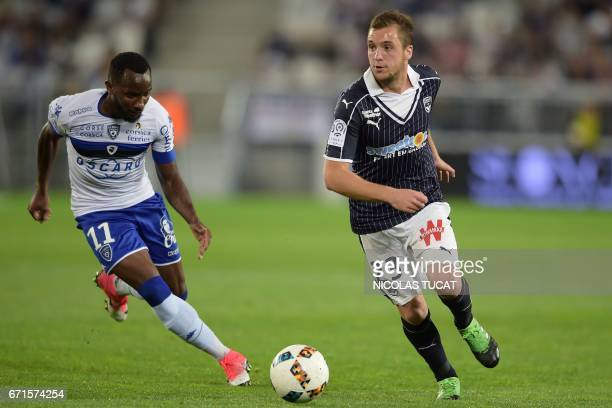 Bordeaux's Argentinian midfielder Valentin Vada vies with Bastia's French midfielder Lenny Nangis during the French Ligue 1 football match between...
