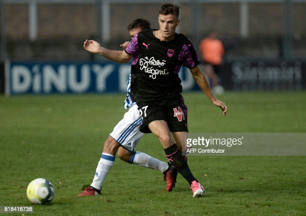 Bordeaux's Bordeaux's defender Frederic Guilbert eyes the ball during the friendly football match Girondins de Bordeaux vs Real Sociedad at GAL...