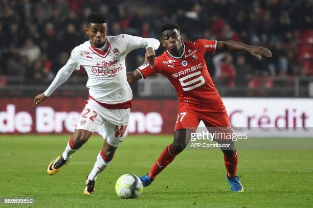 Bordeaux's Brazilian forward Jonathan Cafu vies with Rennes' French midfielder Faitout Maouassa during the French L1 football match between Rennes...