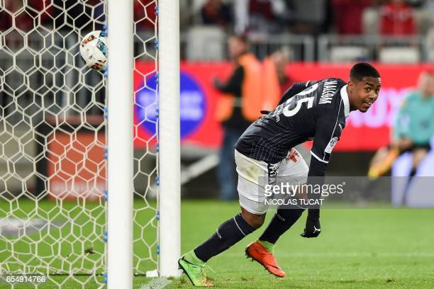 Bordeaux's Brazilian forward Malcom celebrates after scoring a goal during the French L1 football match between Bordeaux and Montpellier on March 18...