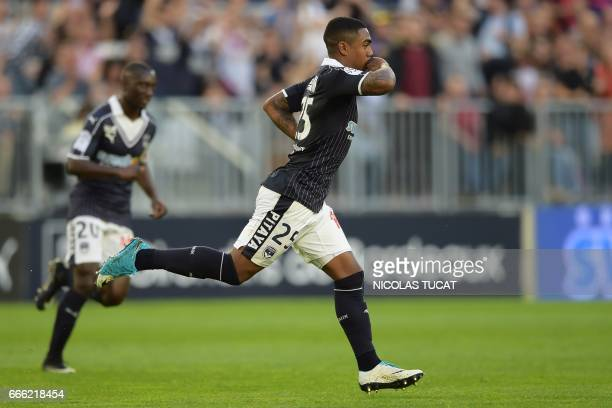 Bordeaux's Brazilian forward Malcom celebrates after scoring a goal during the French Ligue 1 football match between Bordeaux and Metz on April 8...