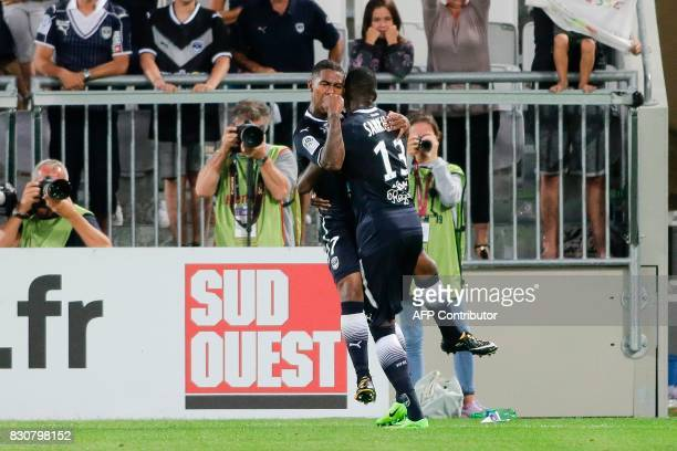 Bordeaux's Brazilian forward Malcom celebrates after scoring a goal with his teammate Bordeaux's Senegalese midfielder Younousse Sankhare during the...