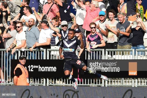 Bordeaux's Brazilian forward Malcom celebrates after scoring a goal during the French L1 football match between Bordeaux and Nantes on October 15 at...