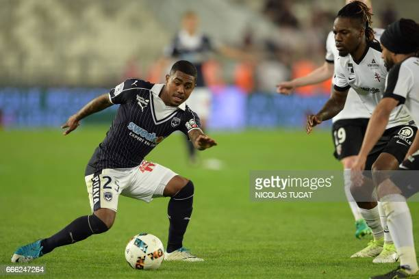 Bordeaux's Brazilian forward Malcom controls the ball during the French Ligue 1 football match between Bordeaux and Metz on April 8 2017 at the...