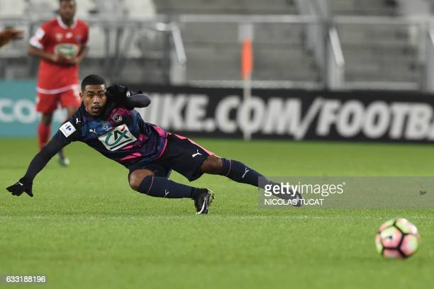 Bordeaux's Brazilian forward Malcom falls as he passes the ball during the French Cup football match between Bordeaux and Dijon on January 31 2017 at...