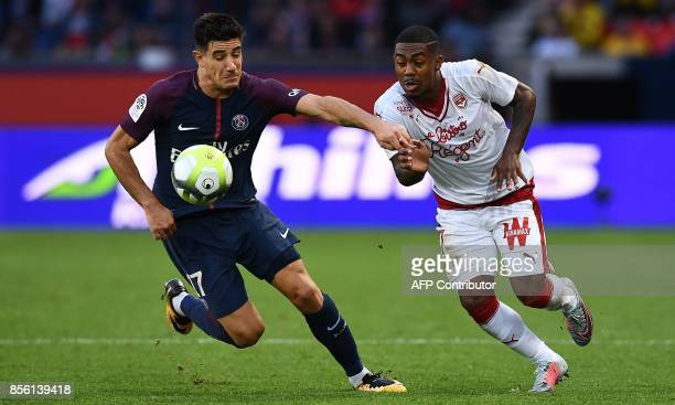 Bordeaux's Brazilian forward Malcom fights for the ball with Paris SaintGermain's Spain defender Yuri Berchiche during the French Ligue 1 football...