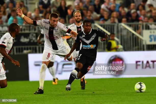 Bordeaux's Brazilian forward Malcom outruns Guincamp's French midfielder Lucas Deaux during the French L1 football match between Bordeaux and...