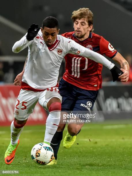 Bordeaux's Brazilian forward Malcom outruns Lille's Portuguese midfielder Xeka during the French L1 football match Lille vs Bordeaux on Februrary 25...
