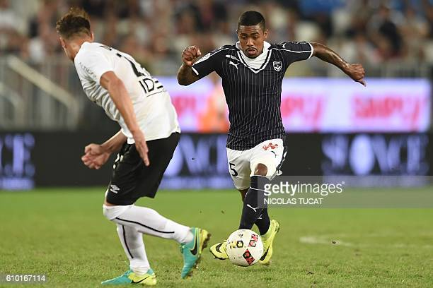 Bordeaux's Brazilian forward Malcom runs with the ball during the French L1 football match between Bordeaux and Caen on September 24 2016 at the...