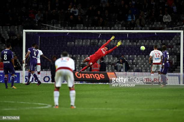 Bordeaux's Brazilian forward Malcom scores a goal in spite of Toulouse's goal Alban Lafon during the French L1 football match Toulouse vs Bordeaux on...