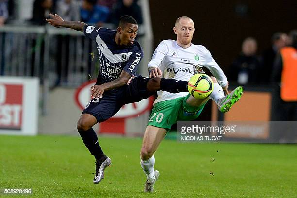 Bordeaux's Brazilian forward Malcom vies for the ball with SaintEtienne's French defender Jonathan Brison during the French L1 football match between...