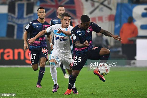 Bordeaux's Brazilian forward Malcom vies for the ball with Olympique de Marseille's French midfielder Maxime Lopez during the French L1 football...