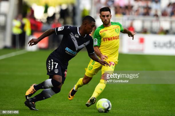 Bordeaux's Brazilian forward Malcom vies with Nantes' French midfielder Adrien Thomasson during the French L1 football match between Bordeaux and...