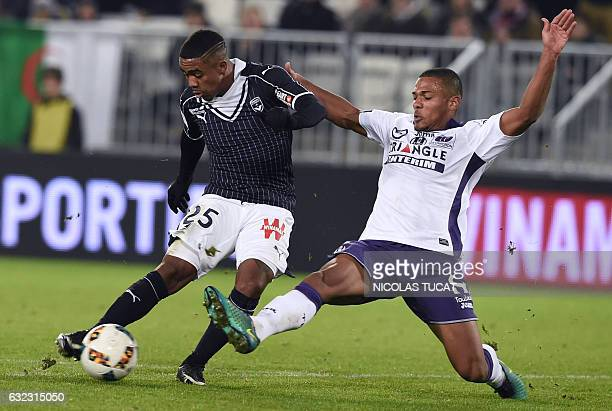 Bordeaux's Brazilian forward Malcom vies with Toulouse's defender Kelvin Amian Adou during the French L1 football match between Bordeaux and Toulouse...