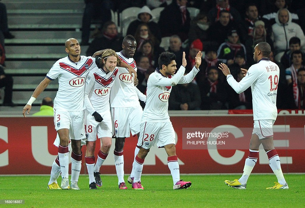 Bordeaux's Czech midfielder Jaroslav Plasil (2nd L) is congratulated by teammates after scoring a goal during the French L1 football match Lille (LOSC) vs Bordeaux (FCGB) on March 3, 2013 at the Grand Stade Stadium in Villeneuve d'Ascq, northern France.