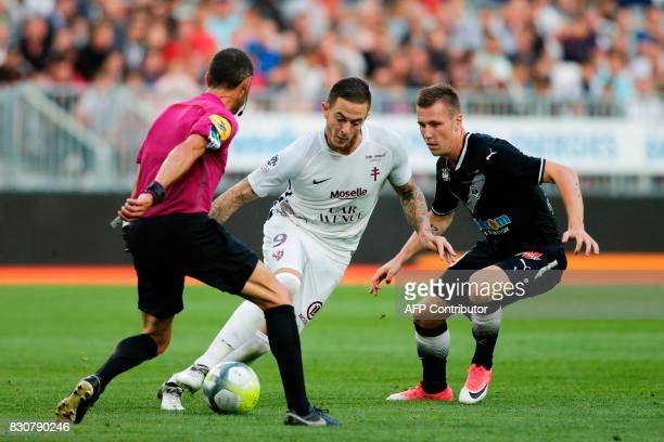 Bordeaux's Danish midfielder Lukas Lerager vies with Metz Metz' French forward Nolan Roux during the French L1 football match Bordeaux vs Metz on...