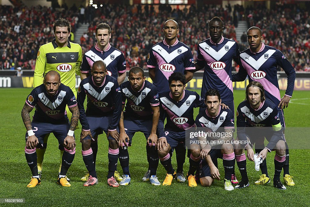 Bordeaux's defender Julien Faubert, Bordeaux's Uruguayan forward Diego Rolan, Bordeaux's Brazilian defender Ferreira Filho Mariano, Bordeaux's French defender Benoit Tremoulinas, Bordeaux's Polish midfielder Ludovic Obraniak, Bordeaux's Czech midfielder Jaroslav Plasil, (second row-from L) Bordeaux's goalkeeper Cedric Carrasso, Bordeaux's midfielder Gregory Sertic, Bordeaux's Brazilian defender Carlos Henrique, Bordeaux's Senegalese defender Lamine Sane, Bordeaux's midfielder Nicolas Maurice-Belay pose before the UEFA Europa League round of 16 first leg football match SL Benfica vs FC Girondins de Bordeaux at the Luz stadium in Lisbon on March 7, 2013.