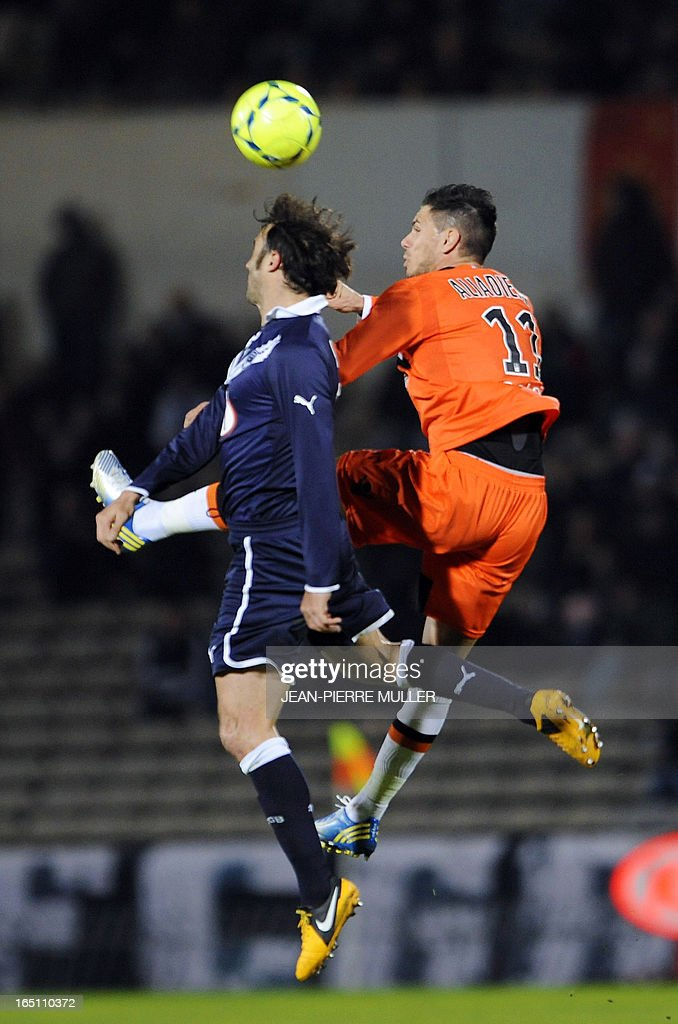 Bordeaux's defender Marc Planus (L) vies for the ball with Lorient's forward Jeremie Aliadiere during the French L1 Football match Bordeaux vs. Lorient on March 30, 2013 at the Chaban-Delmas Stadium in Bordeaux, southwestern france.