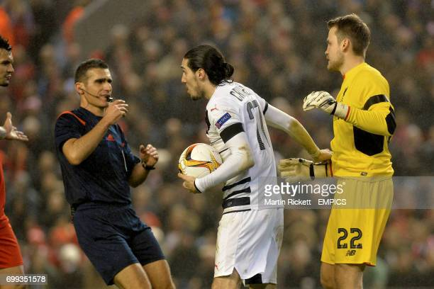 Bordeaux's Enzo Crivelli takes the ball from Liverpool's Simon Mignolet after having been penalised for retaining the ball for too long