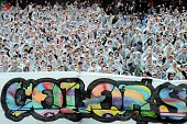 Bordeaux's fans wear plastic bags before throwing colored powders in the air during the French L1 football match between Girondins de Bordeaux and...