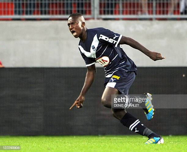 Bordeaux's forward Abdou Traore celebrates after scoring a goal during the French L1 football match Valenciennes vs Bordeaux on August 27 2011 at Le...