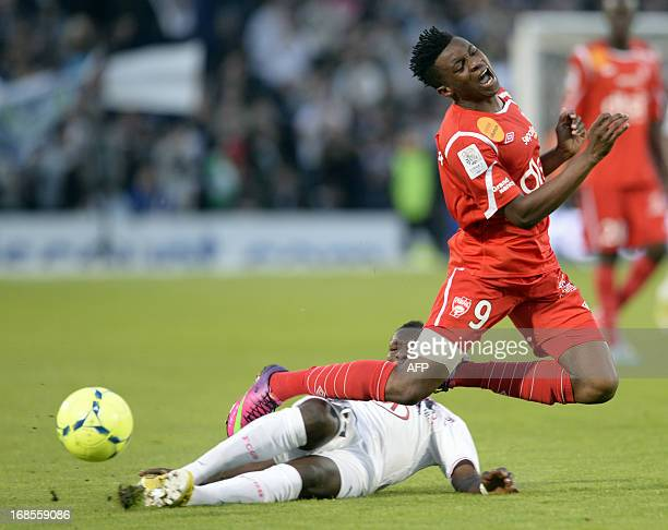 Bordeaux's forward Abdou Traore vies for the ball with Nancy's midfielder Benjamin Moukandjo Bile during the French L1 Football match between...