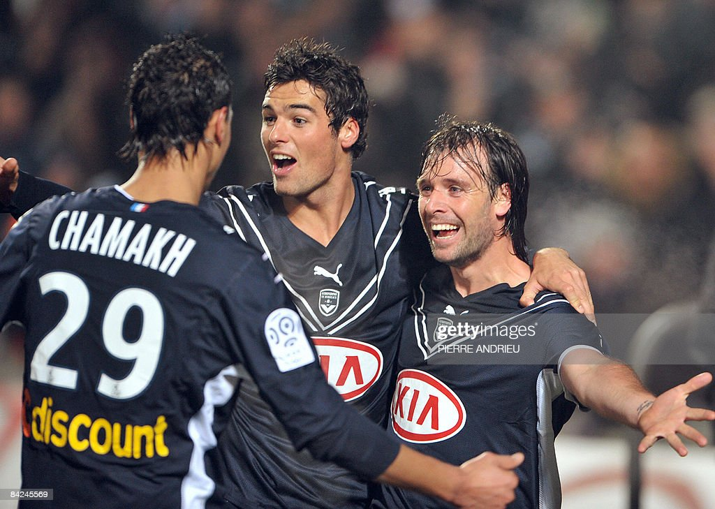 Bordeaux's forward Marouane Chamakh forward Fernando Cavenaghi and midfielder Yoann Gourcuff celebrate after Bordeaux scored a goal during the French...