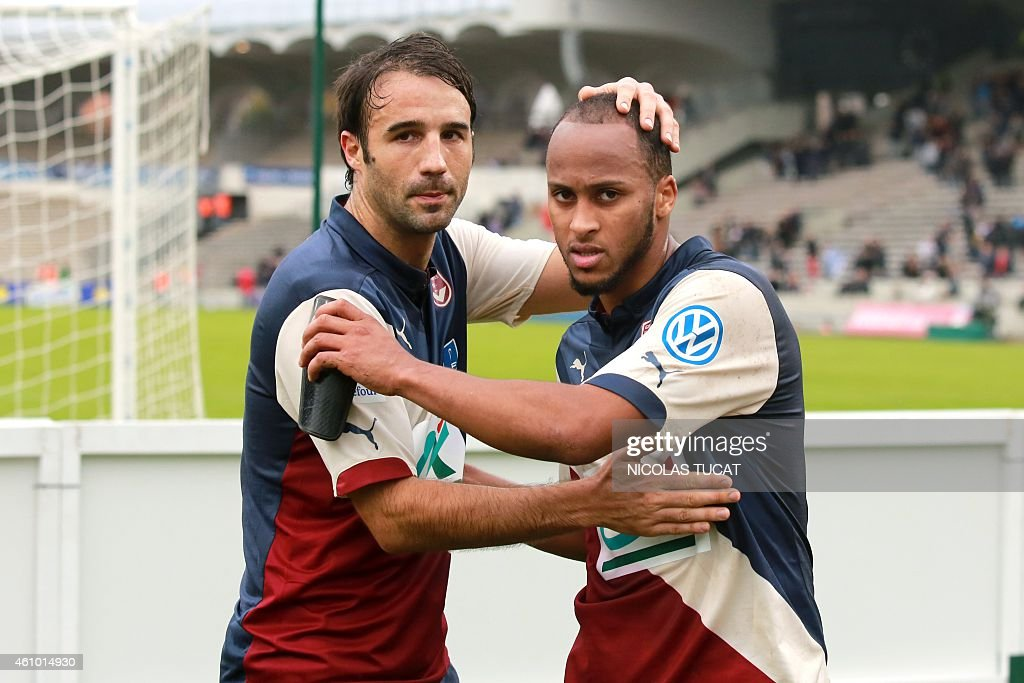 Bordeaux's forward Thomas Toure (R) and defender <a gi-track='captionPersonalityLinkClicked' href=/galleries/search?phrase=Marc+Planus&family=editorial&specificpeople=708262 ng-click='$event.stopPropagation()'>Marc Planus</a> (L) celebrate at the end of the French cup round of 64 football match between Girondins de Bordeaux (FCGB) and Toulouse (TFC) on January 4, 2015 at the Chaban-Delmas stadium in Bordeaux, southwestern France.